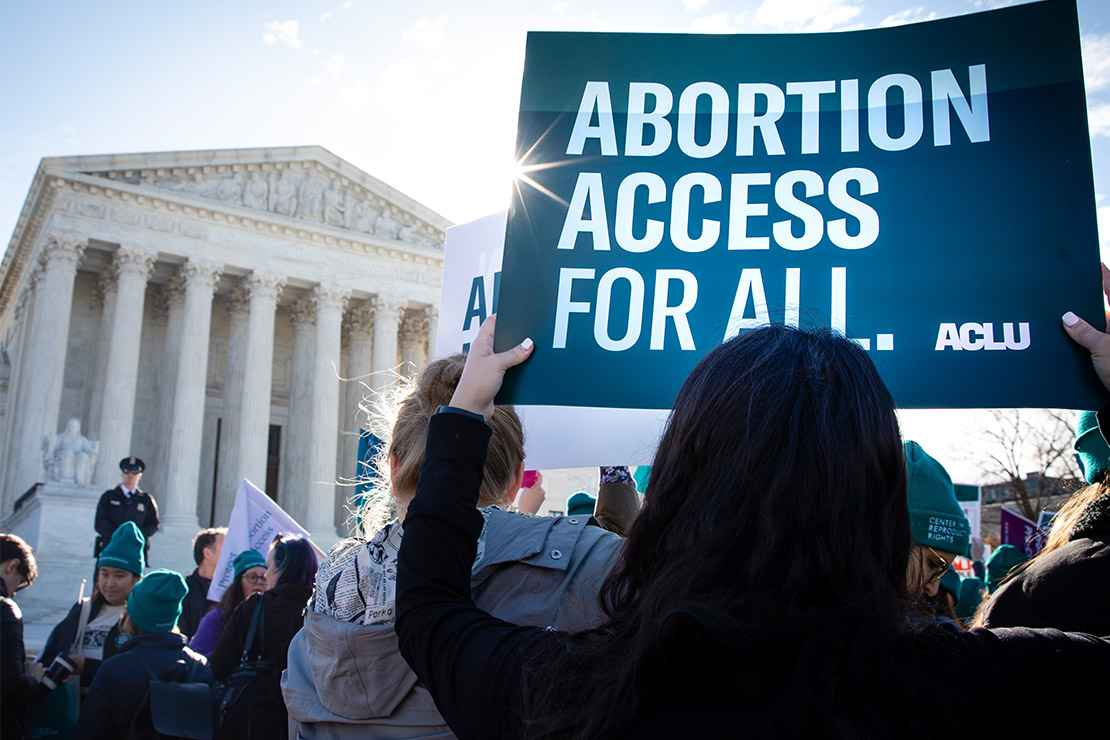 Pro-choice demonstrators outside the Supreme Court with signs advocating abortion access for all.