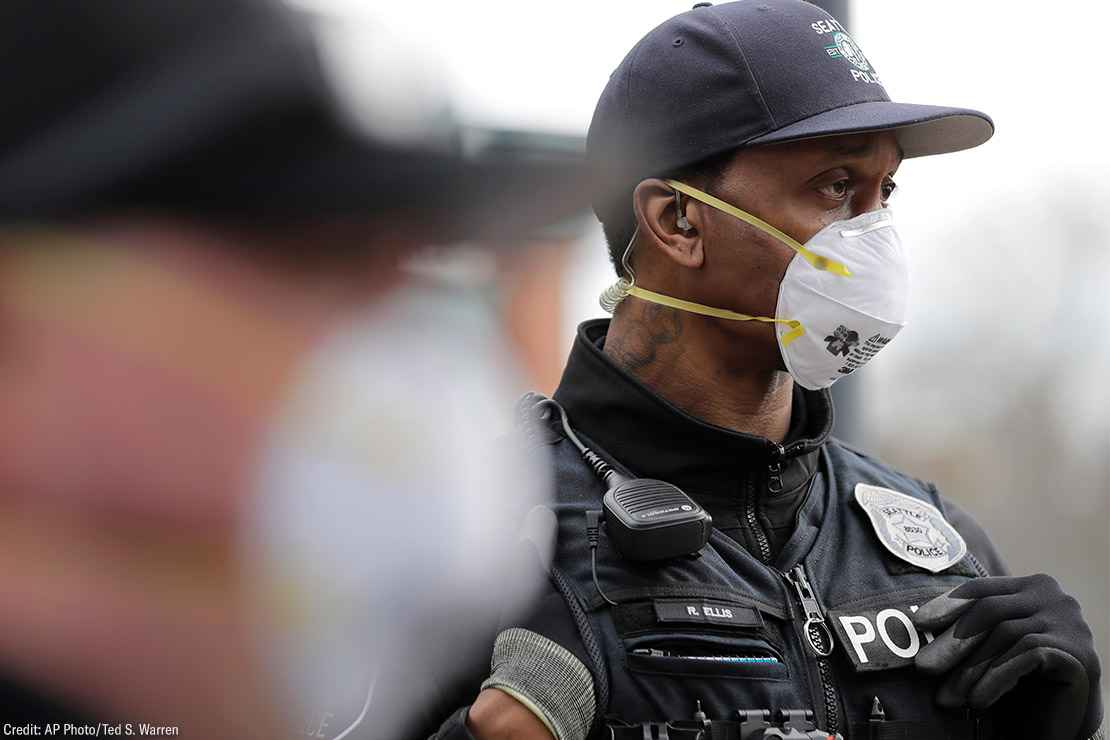 Two Seattle police officers wearing N95 masks.