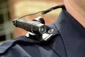 Body camera rests on top of officer's shoulder