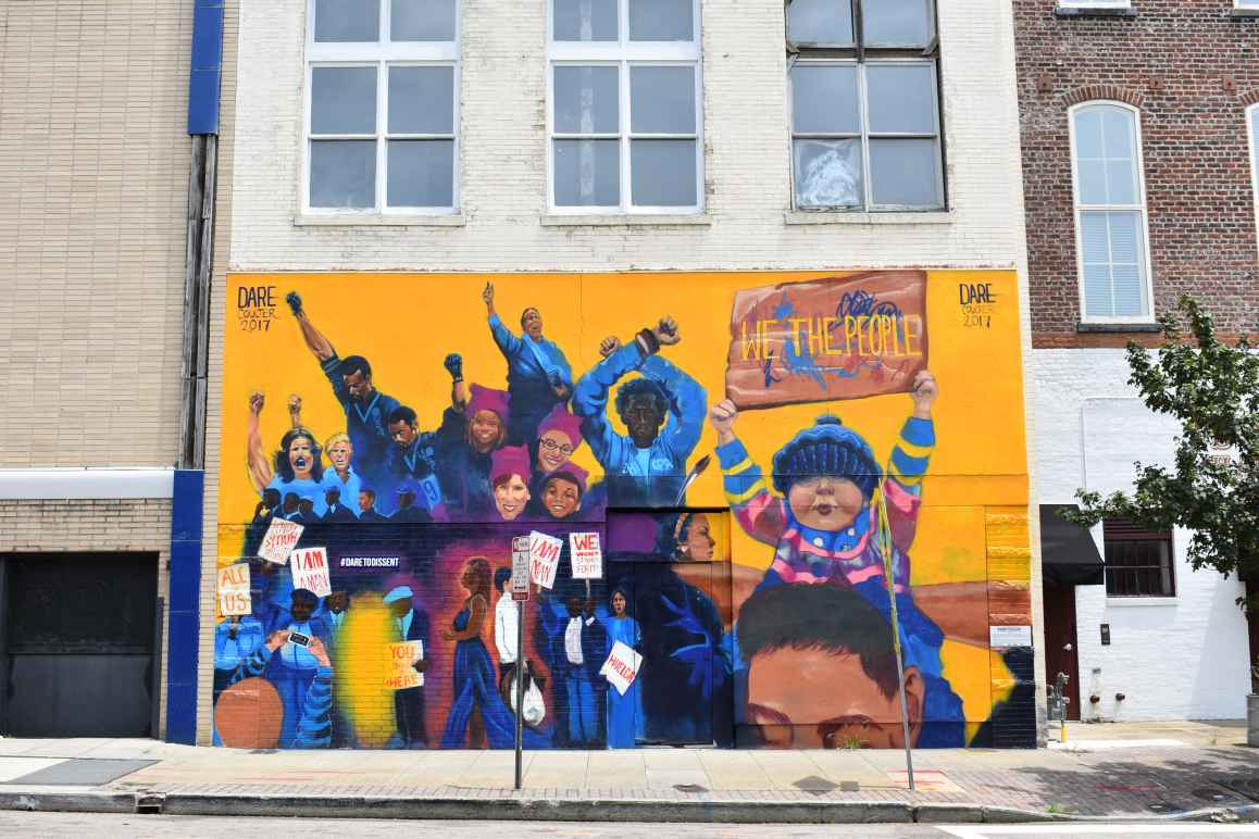 Dare To Dissent mural in downtown Raleigh featuring iconic protests