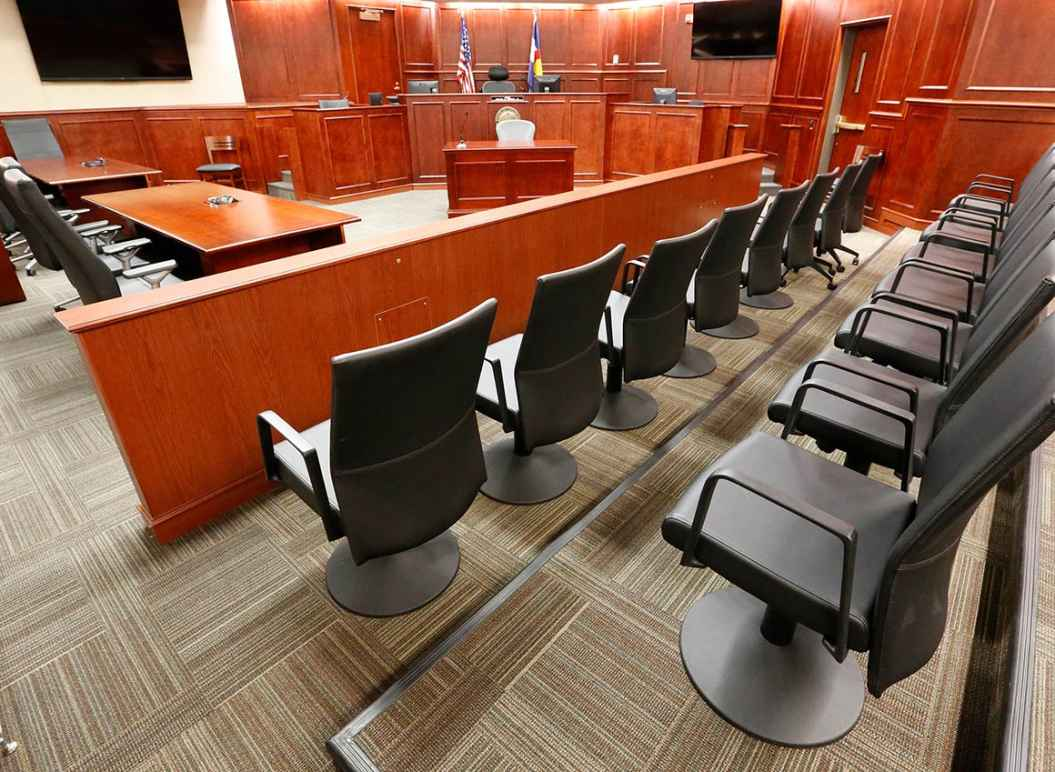 Image of an empty jury box in a courtroom